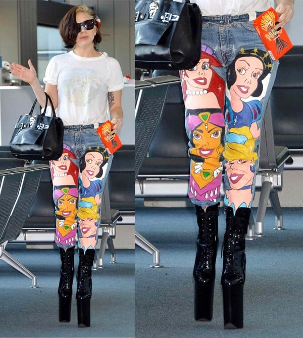 Lady Gaga wears Disney jeans featuring the faces of Snow White, Princess Aurora, Princess Jasmine, and Princess Ariel