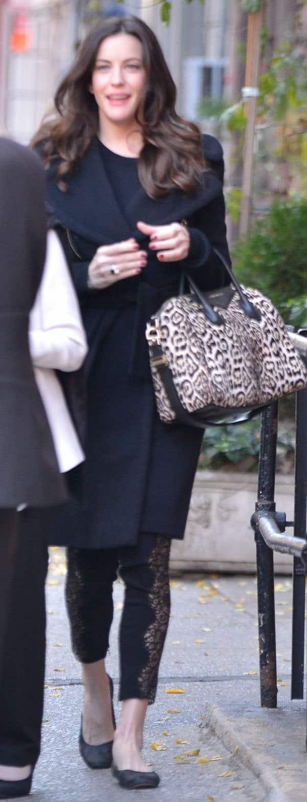 Liv Tyler wore Stella McCartney lace-paneled leggings underneath a bulky gray coat