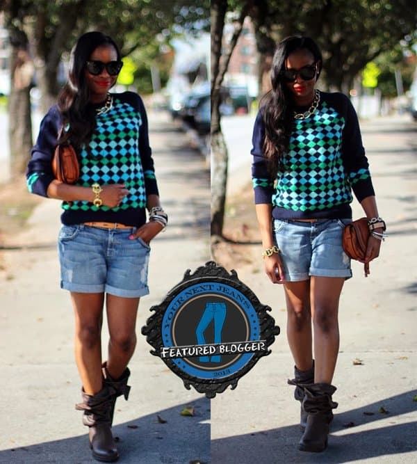 Monica styled her denim shorts with a printed sweater and boots