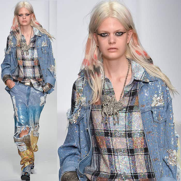 Miley Cyrus' denim jacket and jeans on the Ashish spring 2014 catwalk, shown during London Fashion Week in London, England, on September 14, 2013