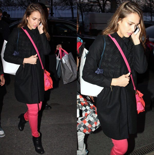 Jessica Alba on the phone arrives at her hotel surrounded by her fans in Paris, France, on March 1, 2012