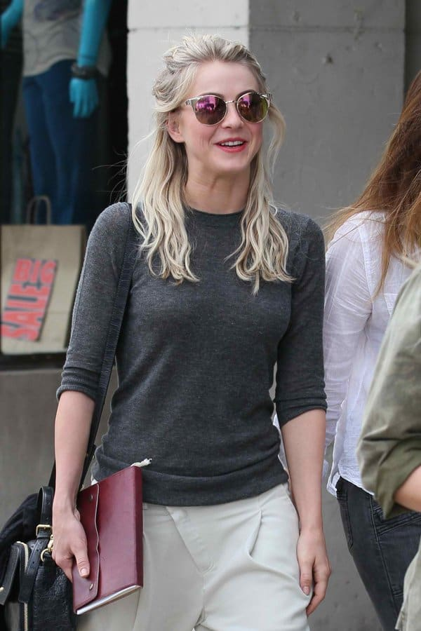 Julianne Hough rocks partially rimmed cat-eye sunglasses from Quay Australia with a cool, vintage vibe featuring adjustable nose pads for no-slip wear