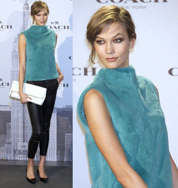 Karlie Kloss wears leather pants at the opening of Coach New York Boutique