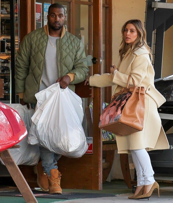 Kim Kardashian spotted with fiancé Kanye West shopping at a sports good store in Los Angeles on December 26, 2013