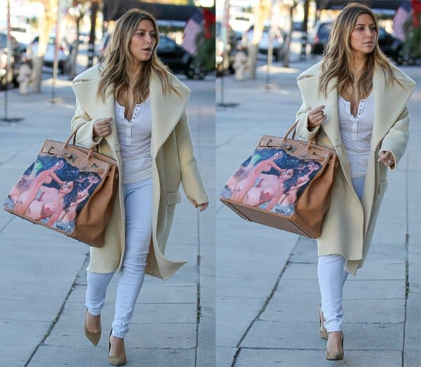 Kim Kardashian wearing a casual white top and a long ivory coat from Céline