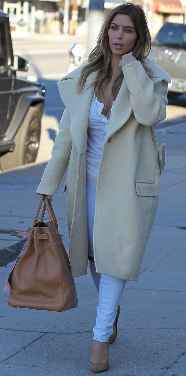 Kim Kardashian paired her white-and-ivory ensemble with Paris pumps from Saint Laurent