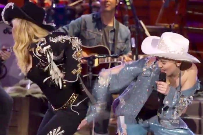Miley Cyrus giving Madonna a friendly spank