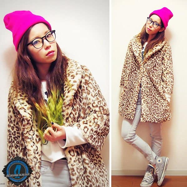 Mizuho wears sneakers with jeans and an animal print coat