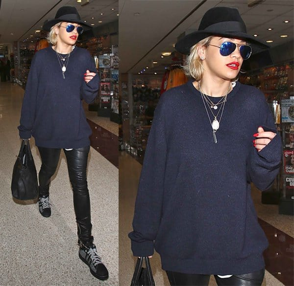 Rita Ora wears leather pants at LAX