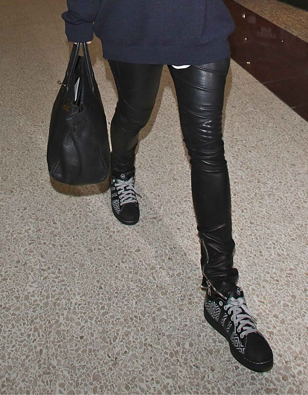 Rita Ora styled her leather pants with sneakers