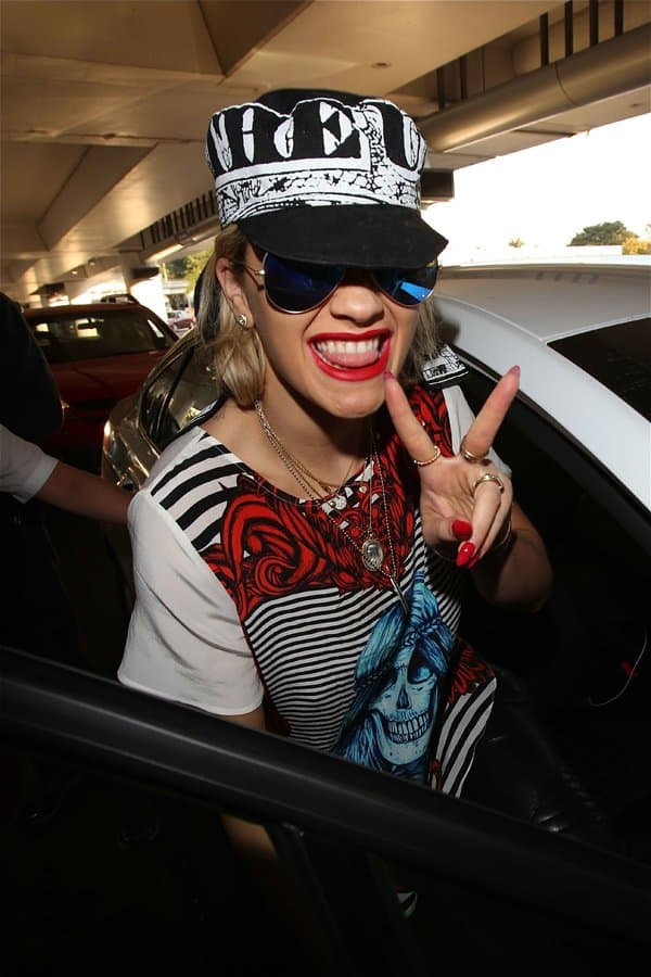 Rita Ora being friendly and in good spirits after a long flight