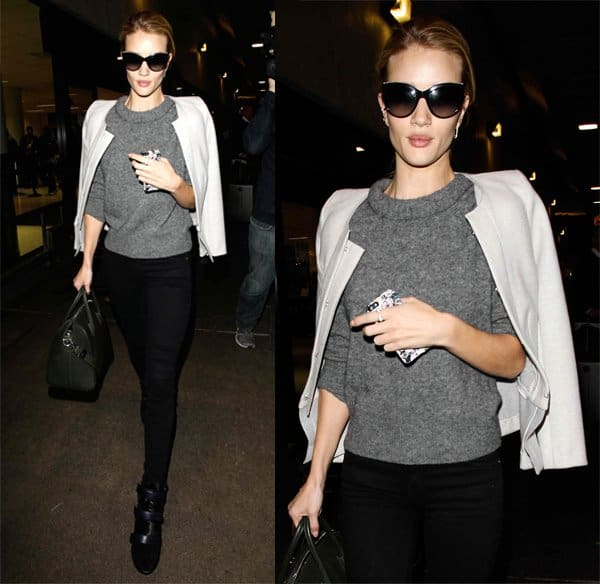 Rosie Huntington Whiteley wore a chunky knitted sweater with a pair of black pants