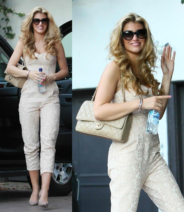 Wearing a white floral print jumpsuit, Amy Willerton stops by a friend's house in West Hollywood