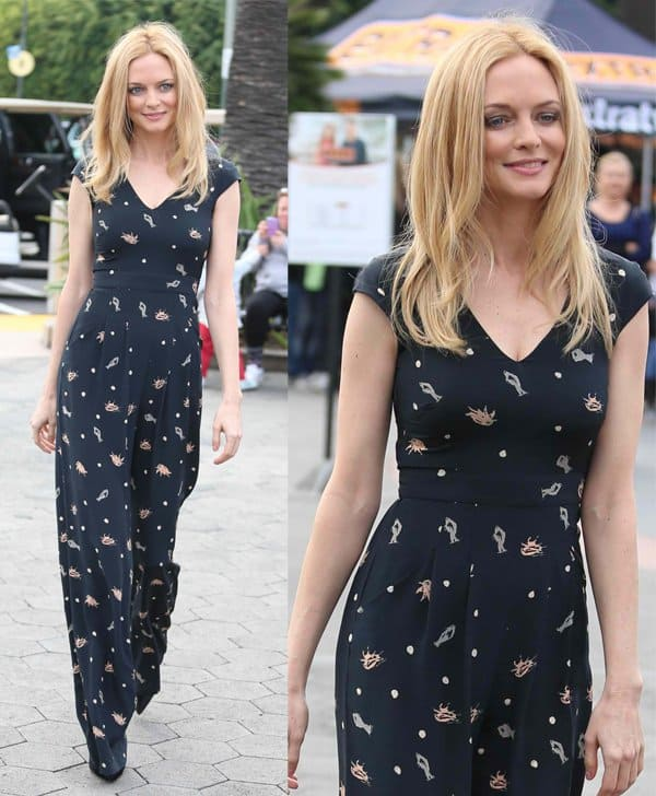 Heather Graham in a 70's inspired jumpsuit appearing on Extra