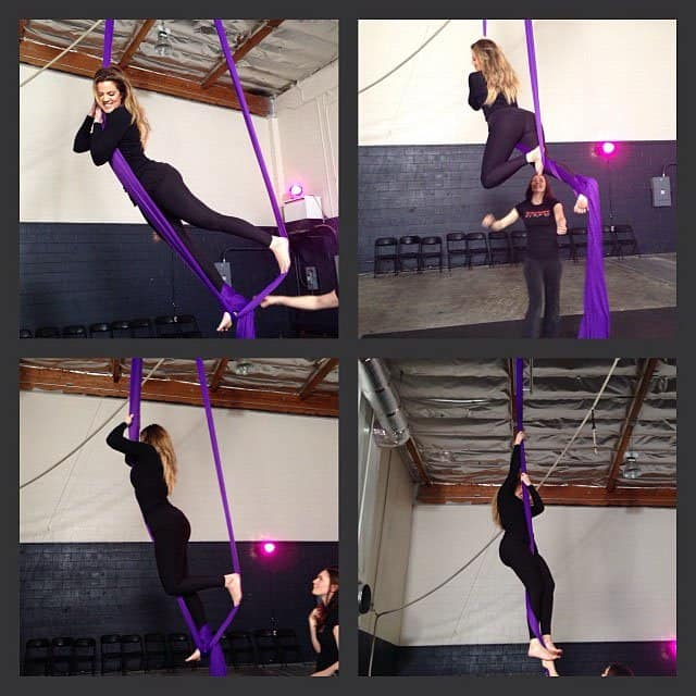 Khloe Kardashian and Kourtney trying out a new aerial workout