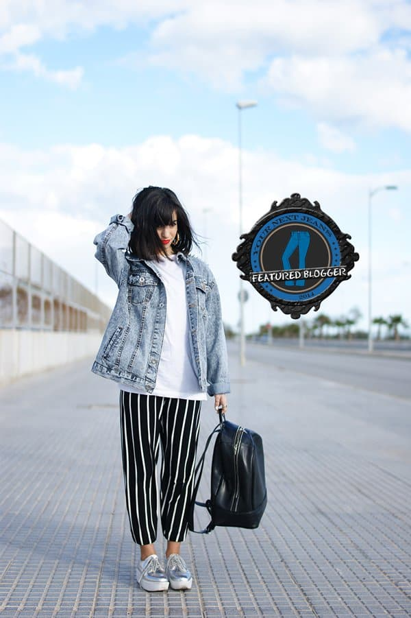 Lucia wearing a tomboy denim jacket with slouchy printed pants
