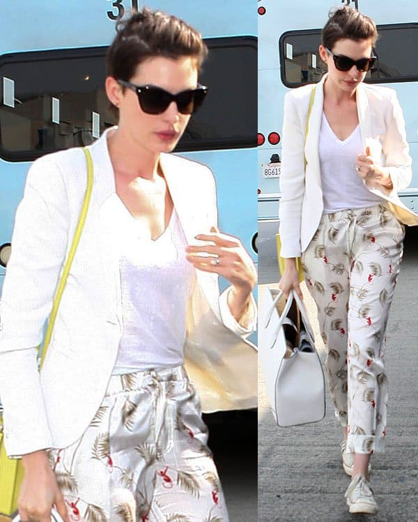 Anne Hathaway wears oversized cat-eye Dior sunglasses