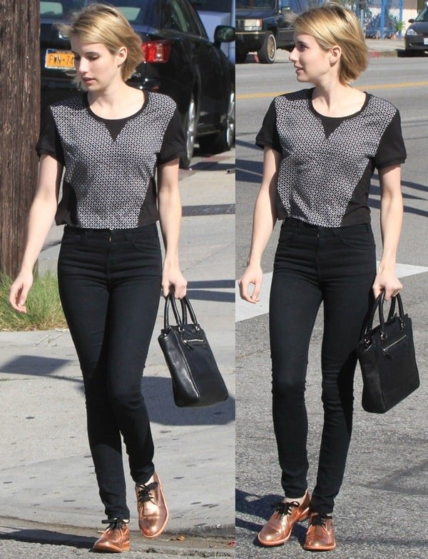 Emma Roberts wears a patterned top and copper shoes