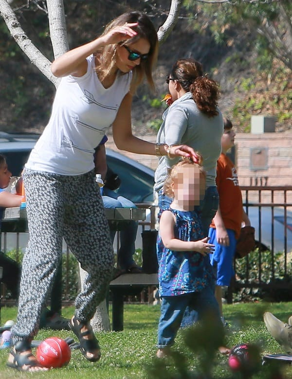 Jessica Alba wears an Aspen cardigan by One Grey Day and floral jog pants by AQUA