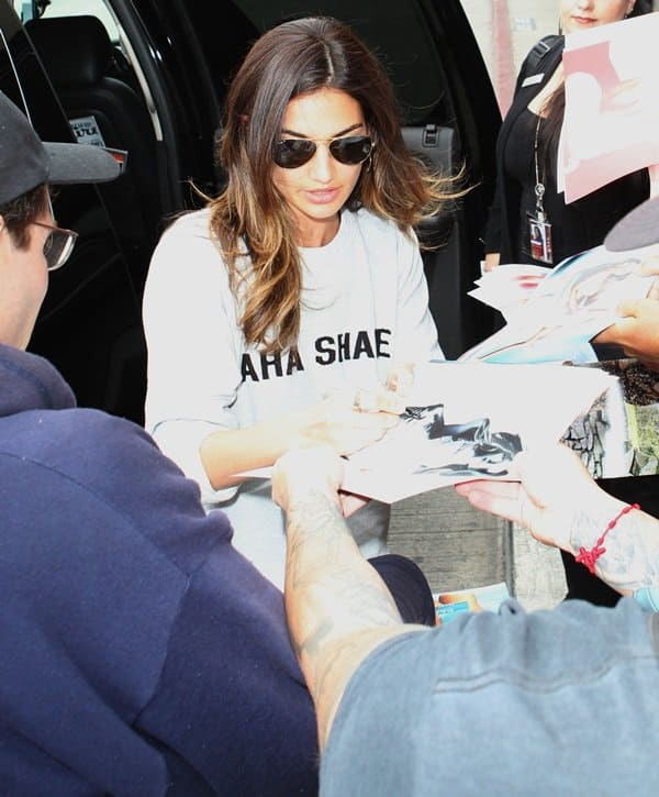 Lily Aldridge wears an Aha Shake Kings of Leon sweatshirt
