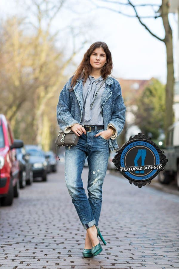 Michele wears a denim jacket with jeans