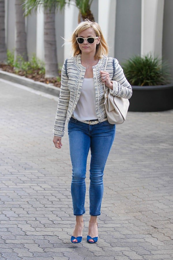 Reese Witherspoon styled her cropped jeans with an embellished jacket by Tory Burch