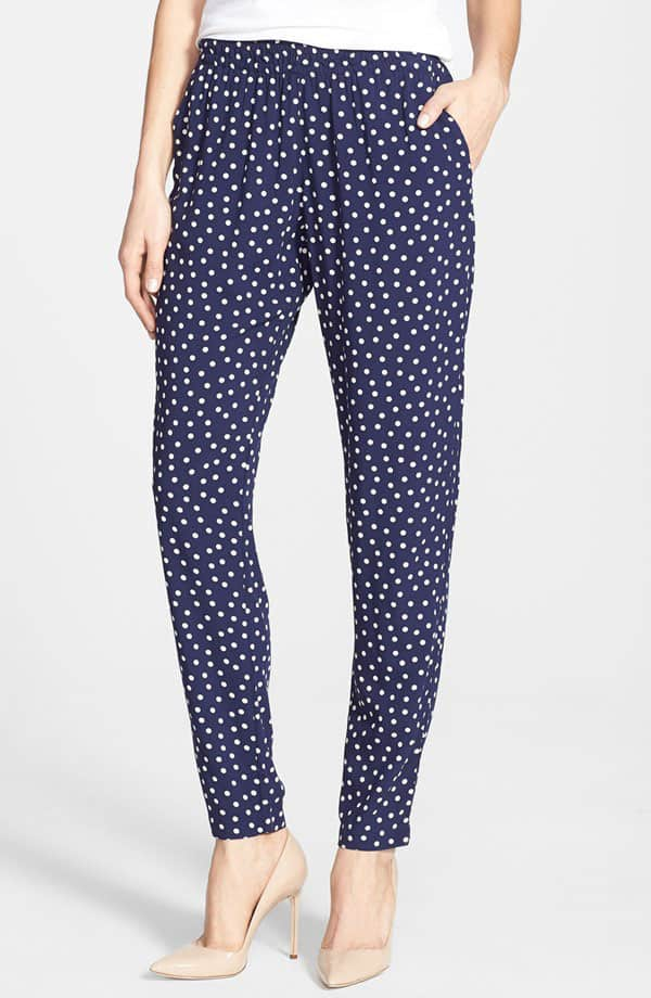 White dots playfully pattern flowy pants designed with an easy elastic waist and pleated for comfortable fullness through the hips and thighs before tapering to a slim end