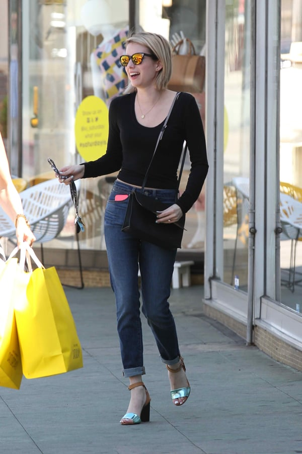 Emma Roberts rocks high-rise denim jeans with a black fitted sweater