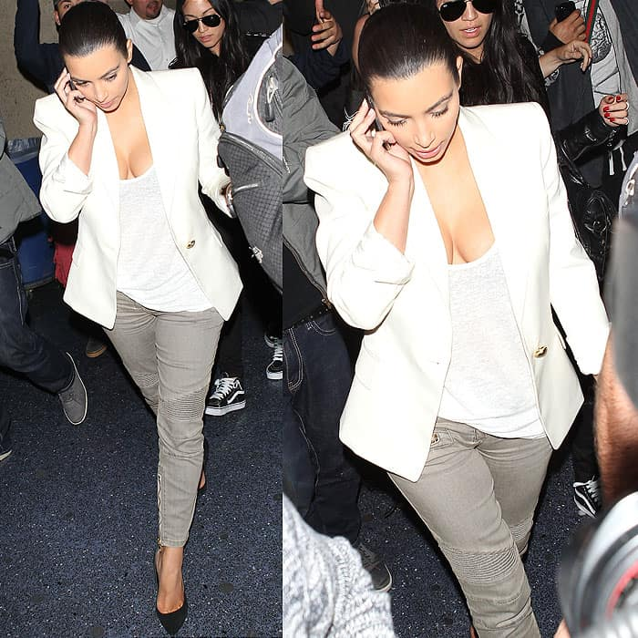 Kim Kardashian wearing a Balmain blazer, t-shirt, and gray jeans