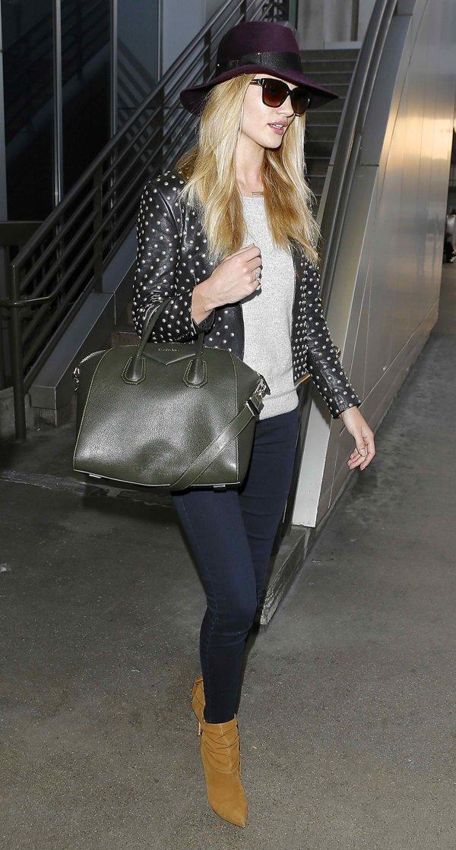Rosie Huntington-Whiteley arrives in dark denim jeans at Los Angeles International (LAX) airport