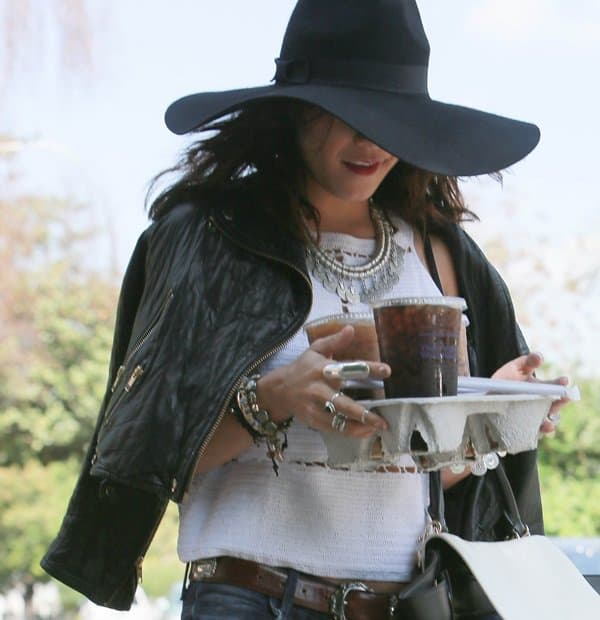 Vanessa Hudgens tries to go undetected wearing an oversized hat as she grabs iced coffees in Los Angeles on March 31, 2014