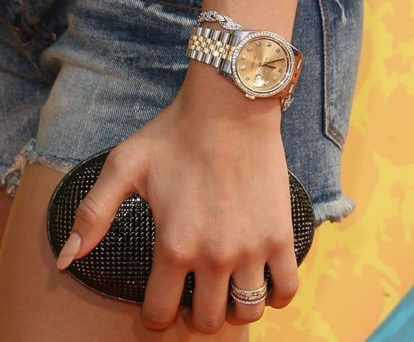 Zendaya shows off her Rolex Datejust watch and vintage Daniel Swarovski clutch