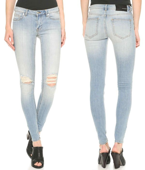 Shredded holes and heavy fading create a worn-in look on figure-hugging BLK DNM skinny jeans