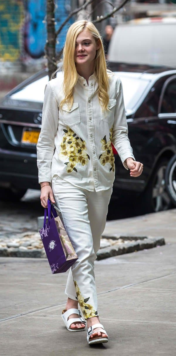 Elle Fanning styled a long-sleeved button-down floral shirt with matching tapered pants