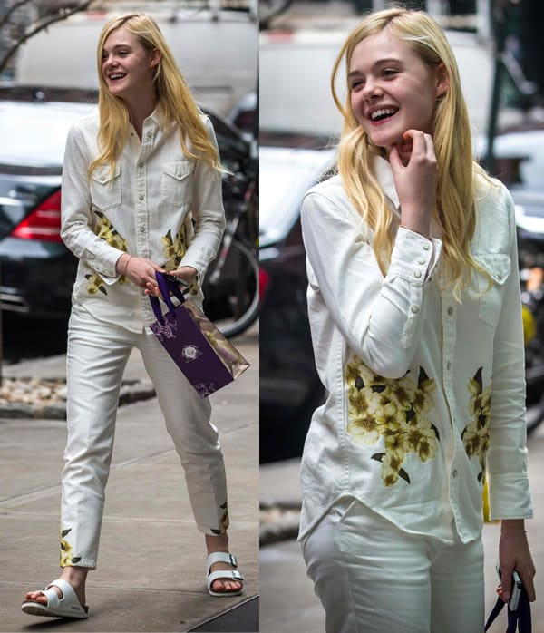 Elle Fanning returns to her hotel wearing a white shirt and pants with a floral print in New York