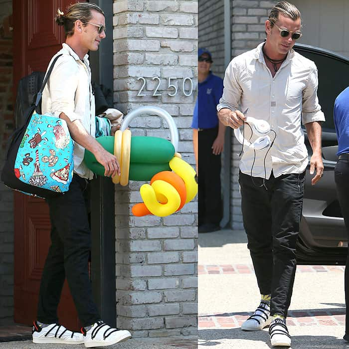 Gavin Rossdale loading their kids' things into their car after attending Joel Silver's Memorial Day party