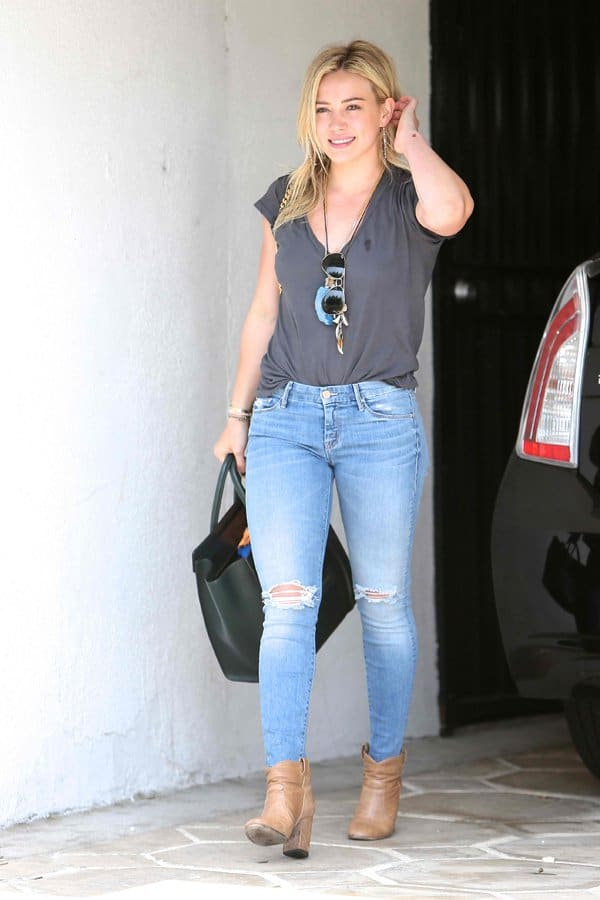 Hilary Duff styled her ripped jeans with a basic V-neck tee