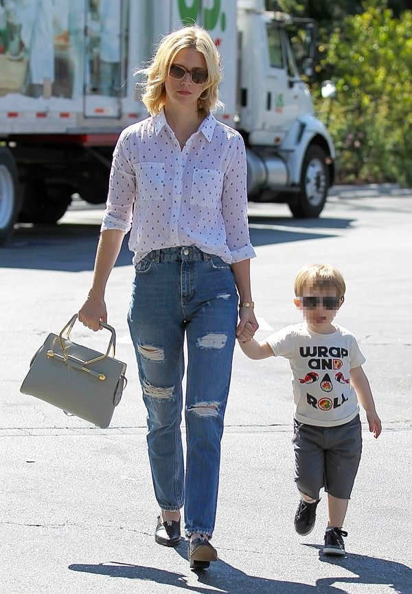 January Jones' button down shirt tucked into her distressed jeans