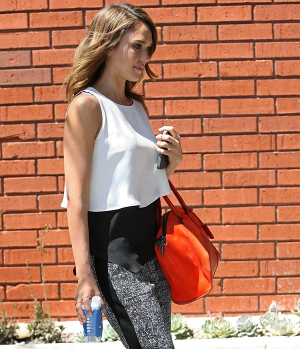Jessica Alba spotted carrying Zico coconut water and a bright orange handbag in Santa Monica on May 2, 2014
