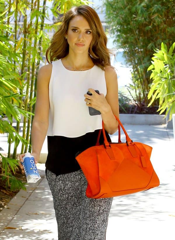 Jessica Alba styled the Sandro Paris pants with a 'Claire' zip tote in cayenne orange suede by Narciso Rodriguez