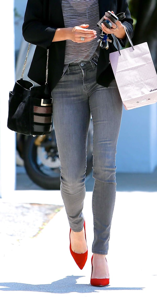 Nikki Reed styled her grey skinny jeans with red suede pointy-toe pumps