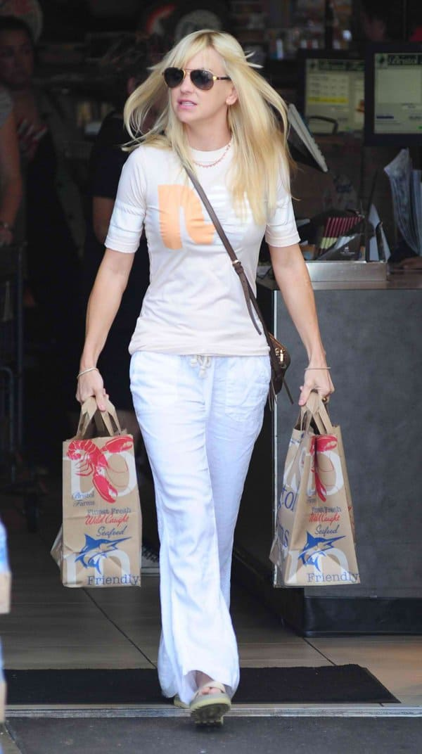 Anna Faris wearing white wide-legged trousers