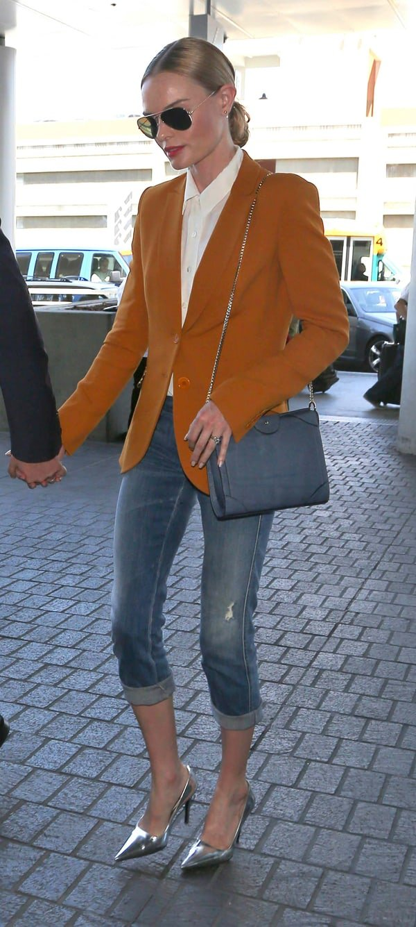 Kate Bosworth wearing three quarter length jeans, brown jacket and silver high heels, leaves Los Angeles International Airport (LAX) holding hands with husband Michael Polish in California on May 14, 2014