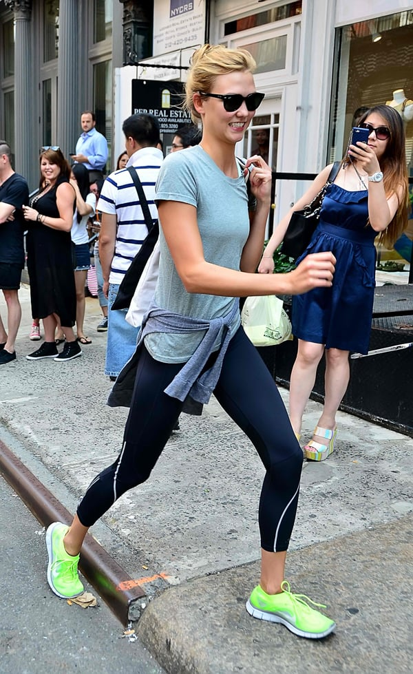 Karlie Kloss looked ready for the guy in sweatpants, a shirt, and neon sneakers