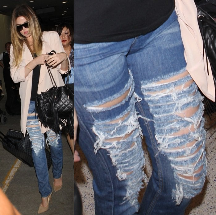 Khloe Kardashian in destroyed jeans at LAX