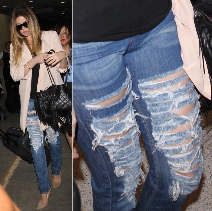 Khloe Kardashian rocks extremely destroyed jeans with big holes