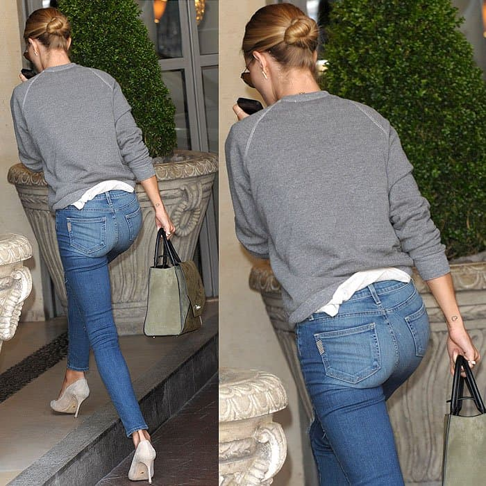 Rosie Huntington-Whiteley in casual blue jeans arriving at The Soho Hotel