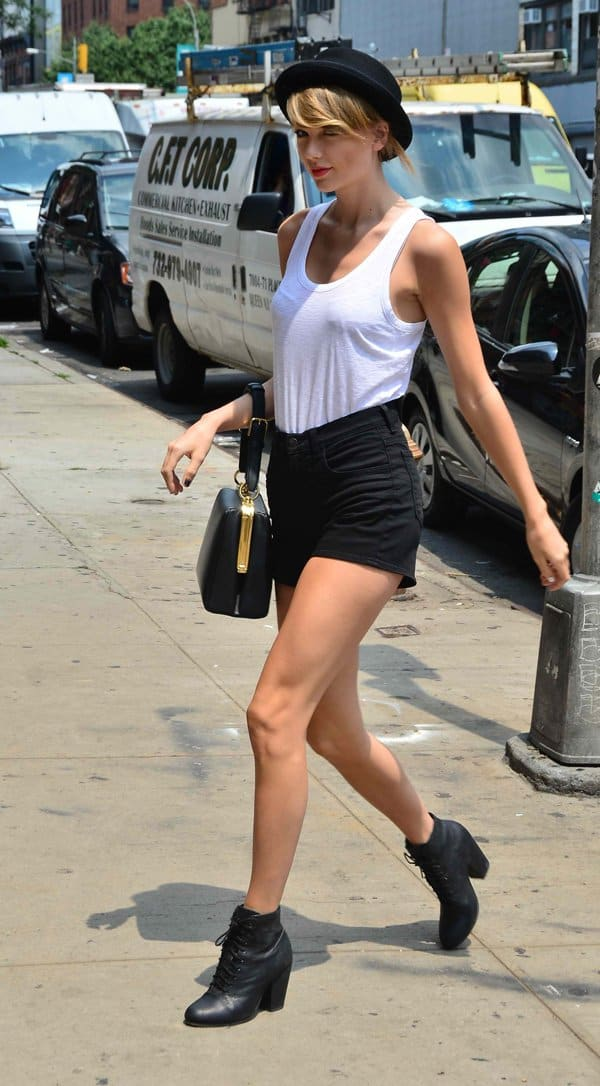 Taylor Swift showing a lot of skin in shorts and a white tank top while out  and about in Manhattan with Karlie Kloss. Swift was spotted carrying her go-to  ... 1590e1ac79488
