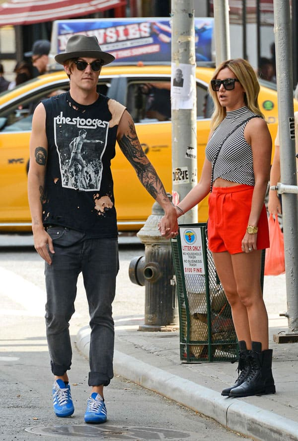 Ashley Tisdale and fiancé Christopher French hold hands in New York City on July 30, 2014
