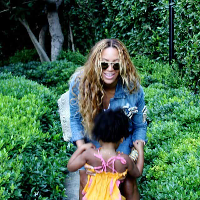 Beyonce playing with her two-year-old daughter Blue Ivy and showing off her curvaceous body on Instagram